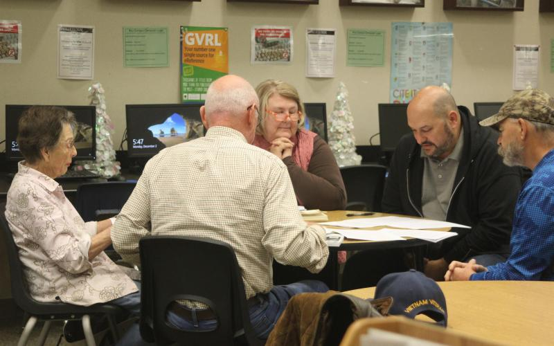 Members of Ink Links, a memior writing group, gather together on Monday, Dec. 2 to read and edit their stories. Photo by Allison Flores/The Cuero Record